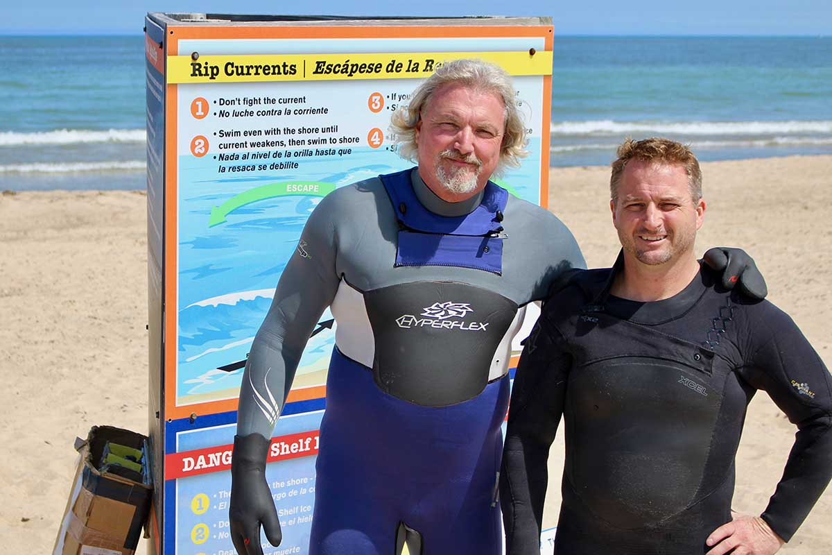 Bob Pratt (left), poses with Dave Benjamin, his partner at the nonprofit Great Lakes Surf Rescue Project. (Bridge photo by Jim Malewitz)