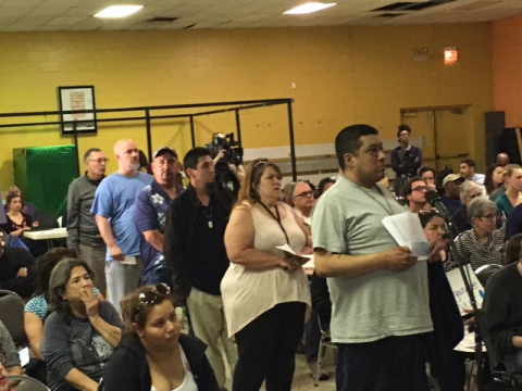 Southeast side Chicago residents line up to speak on air quality problems in their neighborhood. Photo by Gary Wilson