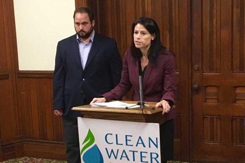 """t a September press conference in Lansing, Dana Nessel said she would work to shut down Line 5 """"as soon as possible."""" Right: Sean McBrearty of the advocacy group Clean Water Action. (Bridge photo by Jim Malewitz)"""