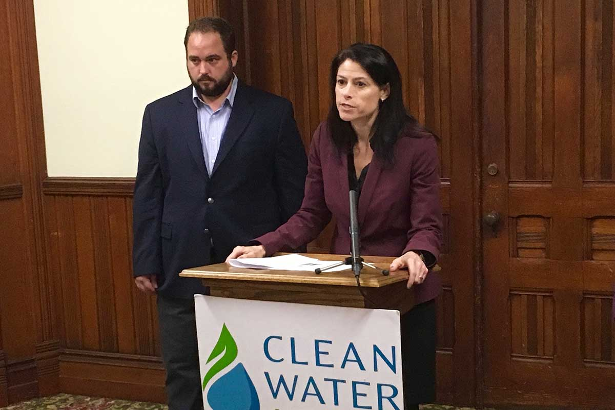 "t a September press conference in Lansing, Dana Nessel said she would work to shut down Line 5 ""as soon as possible."" Right: Sean McBrearty of the advocacy group Clean Water Action. (Bridge photo by Jim Malewitz)"