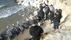 Shifting sand, water again reveal shipwreck from 1880s