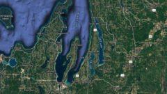 Illinois woman swims across iconic Michigan lake twice